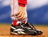 Pitcher Curt Schilling of the Boston Red Sox grabs at his ankle as it appears to be bleeding in the fourth inning during game six of the American...