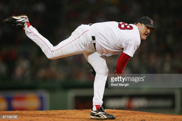 Pitcher Curt Schilling of the Boston Red Sox pitches during game two of the 2004 World Series against the St Louis Cardinals at Fenway Park on...