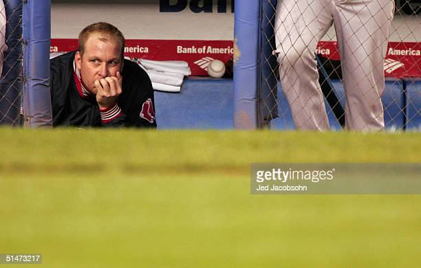 Pitcher Curt Schilling of the Boston Red Sox sits dejected in the dugout in the forth inning during game one of the American League Championship...
