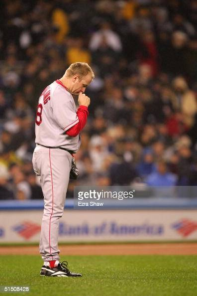Pitcher Curt Schilling of the Boston Red Sox takes a moment to himself before the start of game six of the American League Championship Series...