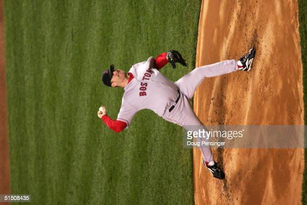Pitcher Curt Schilling of the Boston Red Sox throws a pitch against the New York Yankees in the second inning during game six of the American League...