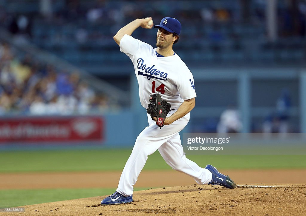 Pitcher <a gi-track='captionPersonalityLinkClicked' href=/galleries/search?phrase=Dan+Haren&family=editorial&specificpeople=228587 ng-click='$event.stopPropagation()'>Dan Haren</a> #14 of the Los Angeles Dodgers pitches against the Detroit Tigers during the MLB game at Dodger Stadium on April 8, 2014 in Los Angeles, California. The Dodgers defeated the Tigers 3-2 in 10 innings.