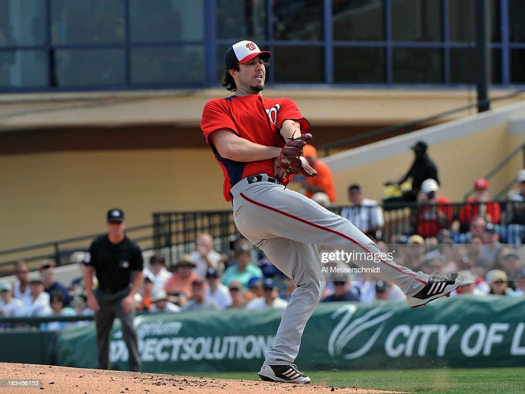 Pitcher <a gi-track='captionPersonalityLinkClicked' href=/galleries/search?phrase=Dan+Haren&family=editorial&specificpeople=228587 ng-click='$event.stopPropagation()'>Dan Haren</a> #15 of the Washington Nationals grabs a line drive to the mound against the Detroit Tigers March 10, 2013 at Joker Marchant Stadium in Lakeland, Florida.