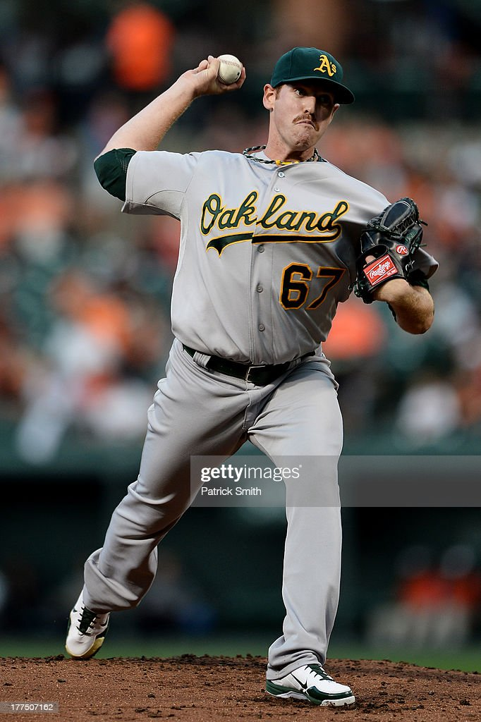Pitcher <a gi-track='captionPersonalityLinkClicked' href=/galleries/search?phrase=Dan+Straily&family=editorial&specificpeople=9615114 ng-click='$event.stopPropagation()'>Dan Straily</a> #67 of the Oakland Athletics works the first inning against the Baltimore Orioles at Oriole Park at Camden Yards on August 23, 2013 in Baltimore, Maryland.