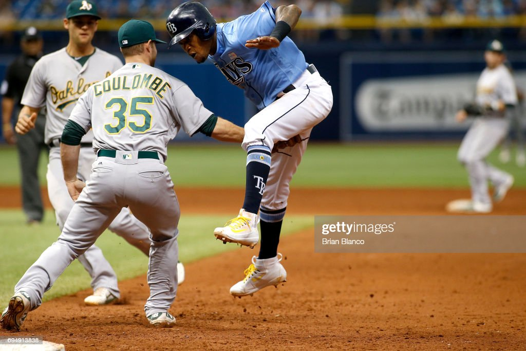 Pitcher Daniel Coulombe #35 of the Oakland Athletics catches Tim Beckham #1 of the Tampa Bay Rays in rundown after Beckham attempted to steal second base to end the sixth inning of a game on June 11, 2017 at Tropicana Field in St. Petersburg, Florida.