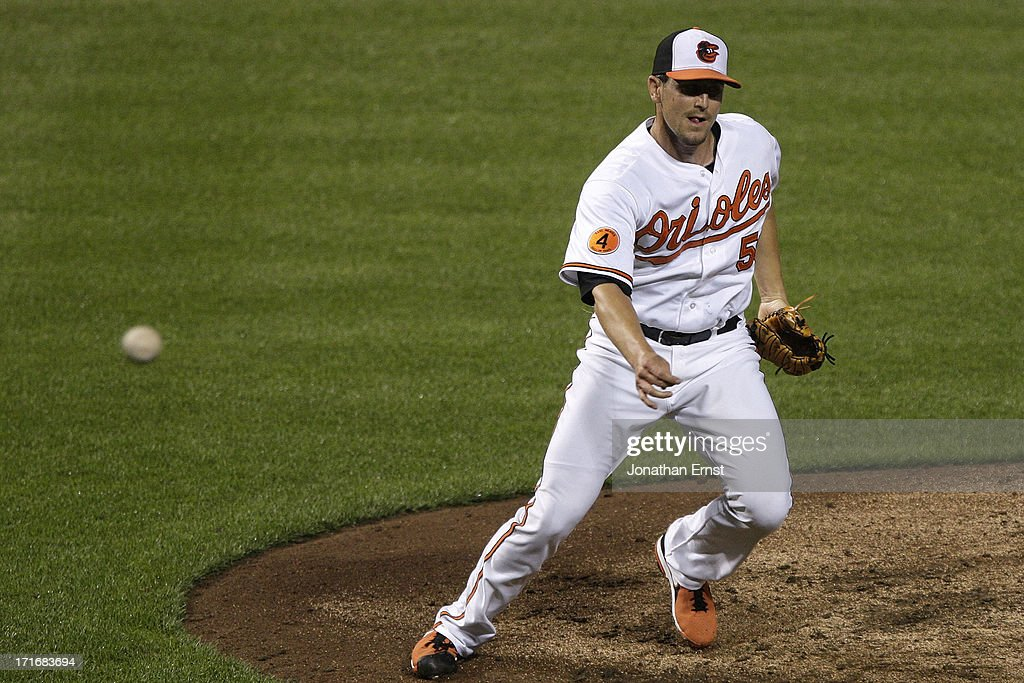 Pitcher Darren O'Day #56 of the Baltimore Orioles induces a ground ball from the Cleveland Indians to get the last out in the ninth inning of their victory at Oriole Park at Camden Yards on June 27, 2013 in Baltimore, Maryland. The Baltimore Orioles won, 7-3.