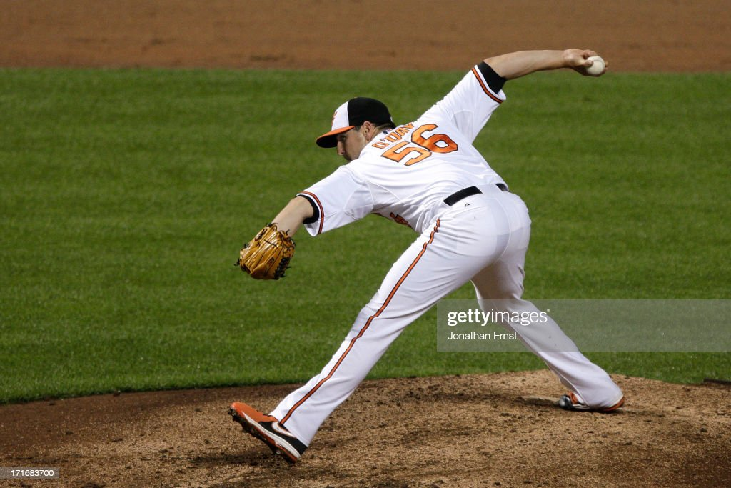 Pitcher Darren O'Day #56 of the Baltimore Orioles pitches against the Cleveland Indians in the ninth inning of their victory at Oriole Park at Camden Yards on June 27, 2013 in Baltimore, Maryland. The Baltimore Orioles won, 7-3.