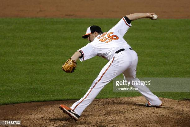 Pitcher Darren O'Day of the Baltimore Orioles pitches against the Cleveland Indians in the ninth inning of their victory at Oriole Park at Camden...