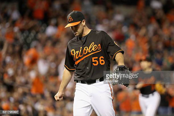 Pitcher Darren O'Day of the Baltimore Orioles reacts after retiring the side in the eighth inning against the Detroit Tigers at Oriole Park at Camden...