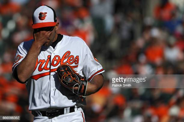 Pitcher Darren O'Day of the Baltimore Orioles wipes his face after walking Chase Headley of the New York Yankees during the ninth inning at Oriole...