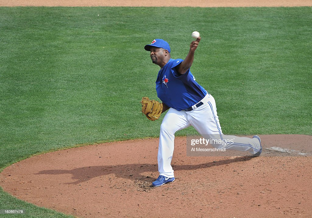 Pitcher <a gi-track='captionPersonalityLinkClicked' href=/galleries/search?phrase=Darren+Oliver&family=editorial&specificpeople=220688 ng-click='$event.stopPropagation()'>Darren Oliver</a> #38 of the Toronto Blue Jays throws in relief against the Boston Red Sox during a preason game February 25, 2013 at the Florida Auto Exchange Stadium in Dunedin, Florida.
