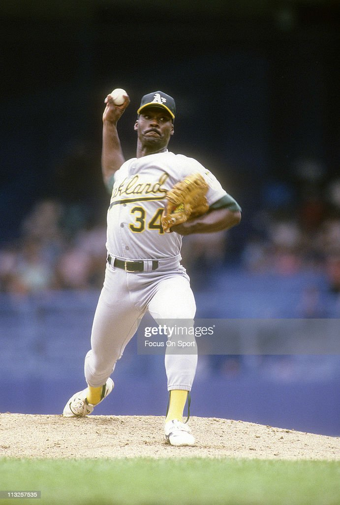 Pitcher Dave Stewart of the Oakland Athletics pitches against the New York Yankees during a Major League Baseball game circa 1990 at Yankee Stadium...