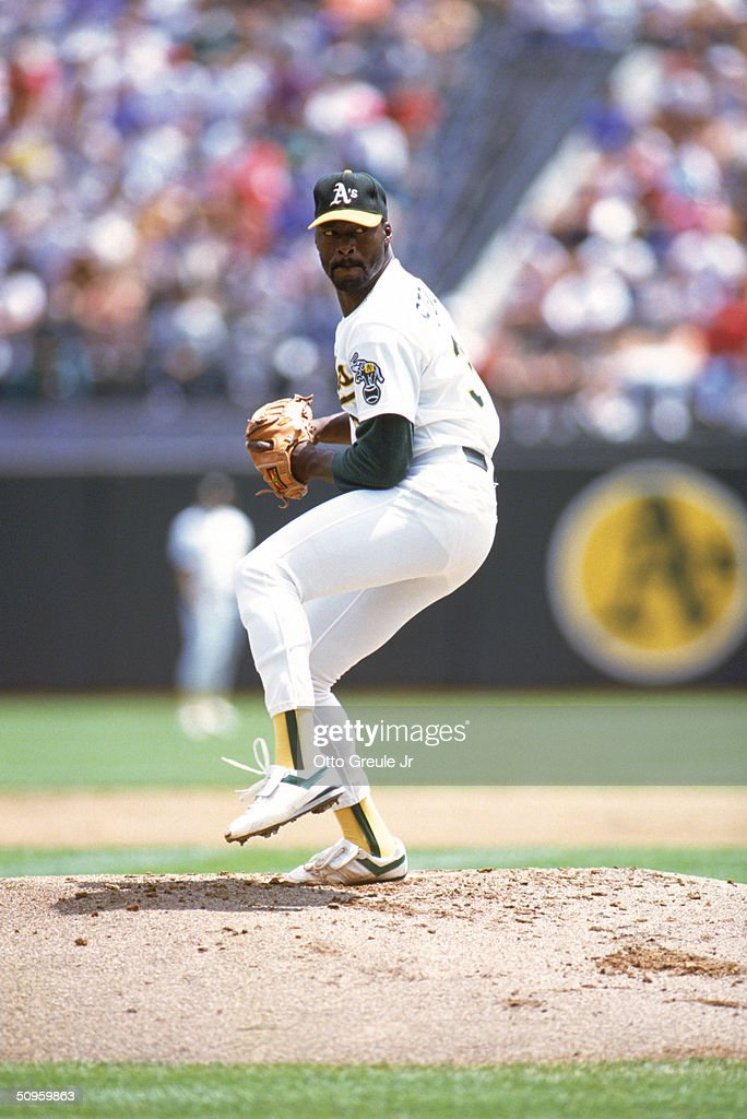 Pitcher Dave Stewart of the Oakland Athletics pitches during the 1990 season at Oakland Alameda County Stadium in Oakland California