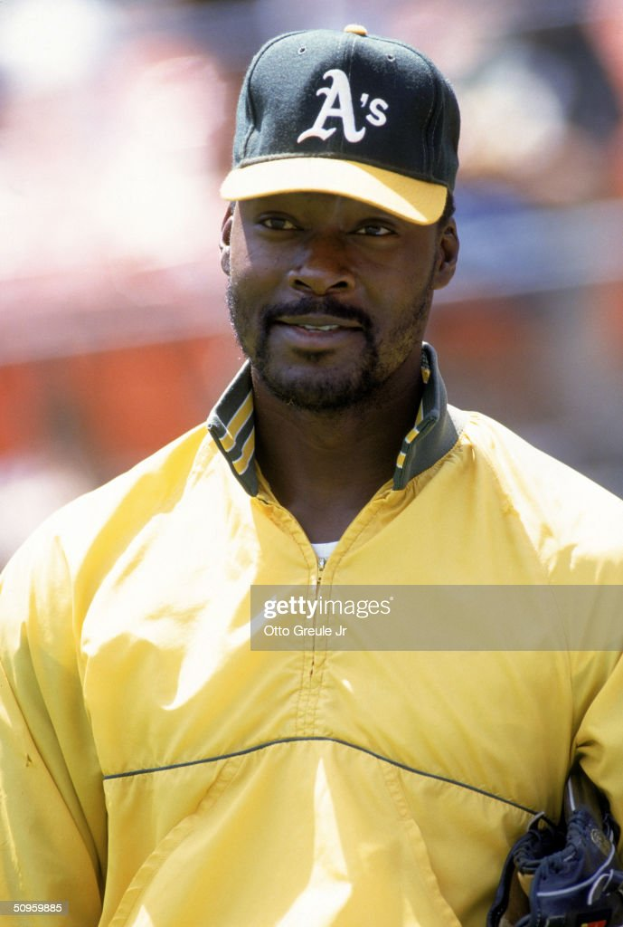Pitcher Dave Stewart of the Oakland Athletics stand on the field before a game during the 1990 season at Oakland Alameda County Stadium in Oakland...