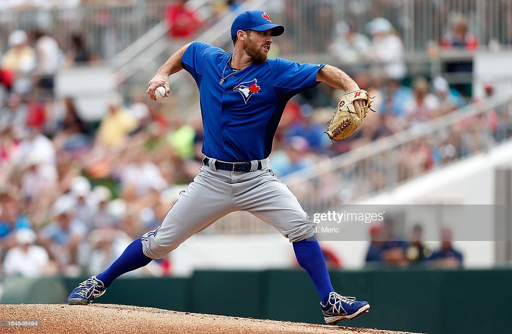 Pitcher David Bush #54 of the Toronto Blue Jays pitches against the Minnesota Twins during a Grapefruit League Spring Training Game at Hammond Stadium on March 24, 2013 in Fort Myers, Florida.