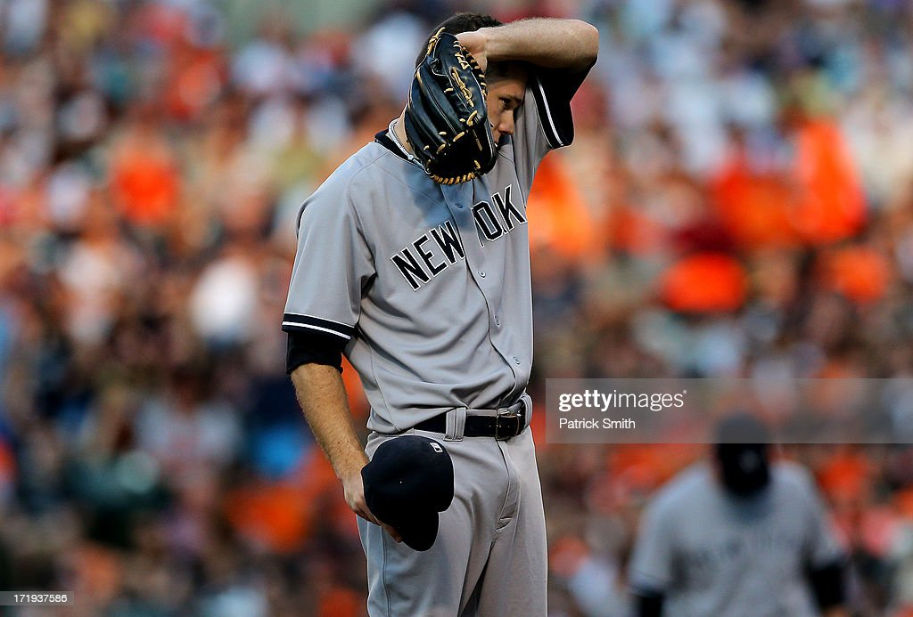 Pitcher David Phelps #41 of the New York Yankees reacts after giving up back to back hits in the first inning against the Baltimore Orioles at Oriole Park at Camden Yards on June 29, 2013 in Baltimore, Maryland.