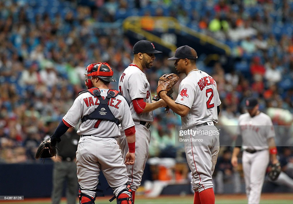Pitcher <a gi-track='captionPersonalityLinkClicked' href=/galleries/search?phrase=David+Price+-+Baseball+Player&family=editorial&specificpeople=4961936 ng-click='$event.stopPropagation()'>David Price</a> #24 of the Boston Red Sox has a conversation on the mound with catcher Christian Vazquez #7 and shortstop <a gi-track='captionPersonalityLinkClicked' href=/galleries/search?phrase=Xander+Bogaerts&family=editorial&specificpeople=9461957 ng-click='$event.stopPropagation()'>Xander Bogaerts</a> #2 after allowing a single to Brad Miller of the Tampa Bay Rays during the third inning of a game on June 29, 2016 at Tropicana Field in St. Petersburg, Florida.