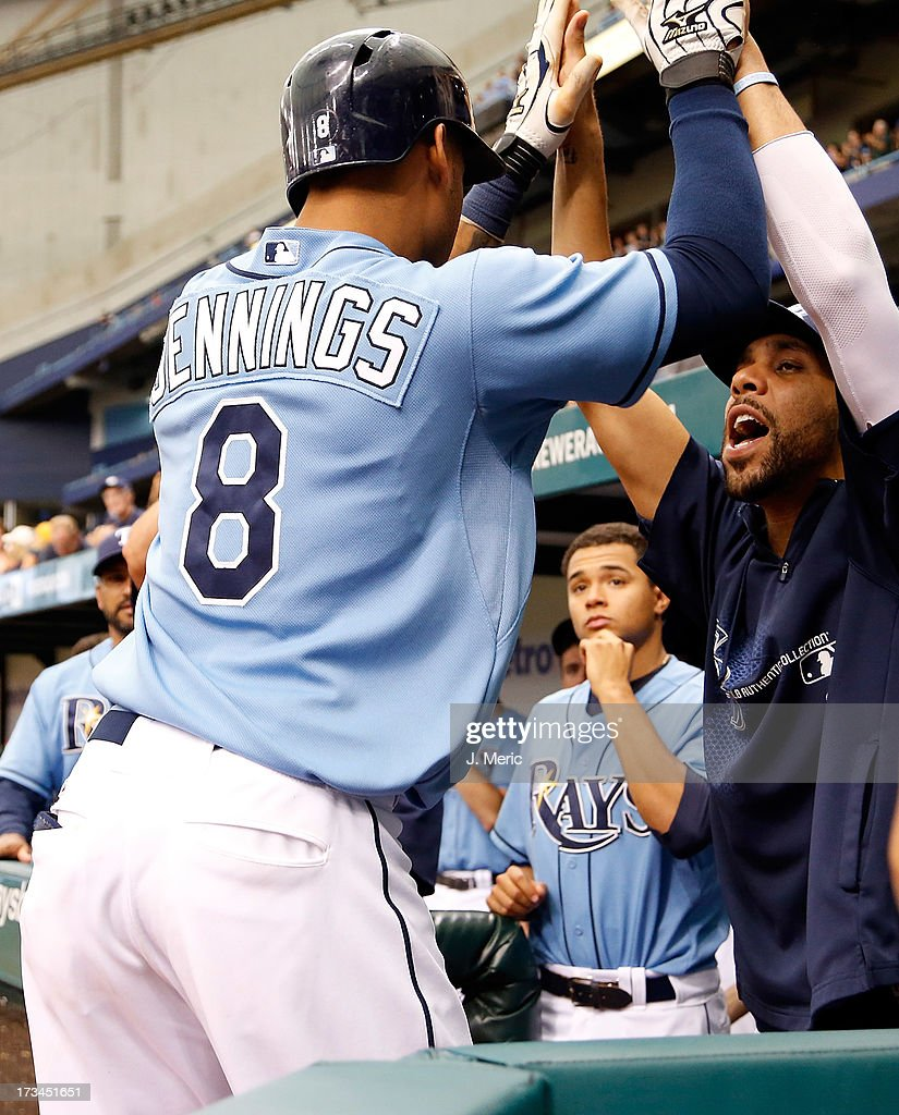 Pitcher David Price #14 of the Tampa Bay Rays congratulates Desmond Jennings #8 after his sixth inning two run home run against the Houston Astros during the game at Tropicana Field on July 14, 2013 in St. Petersburg, Florida.