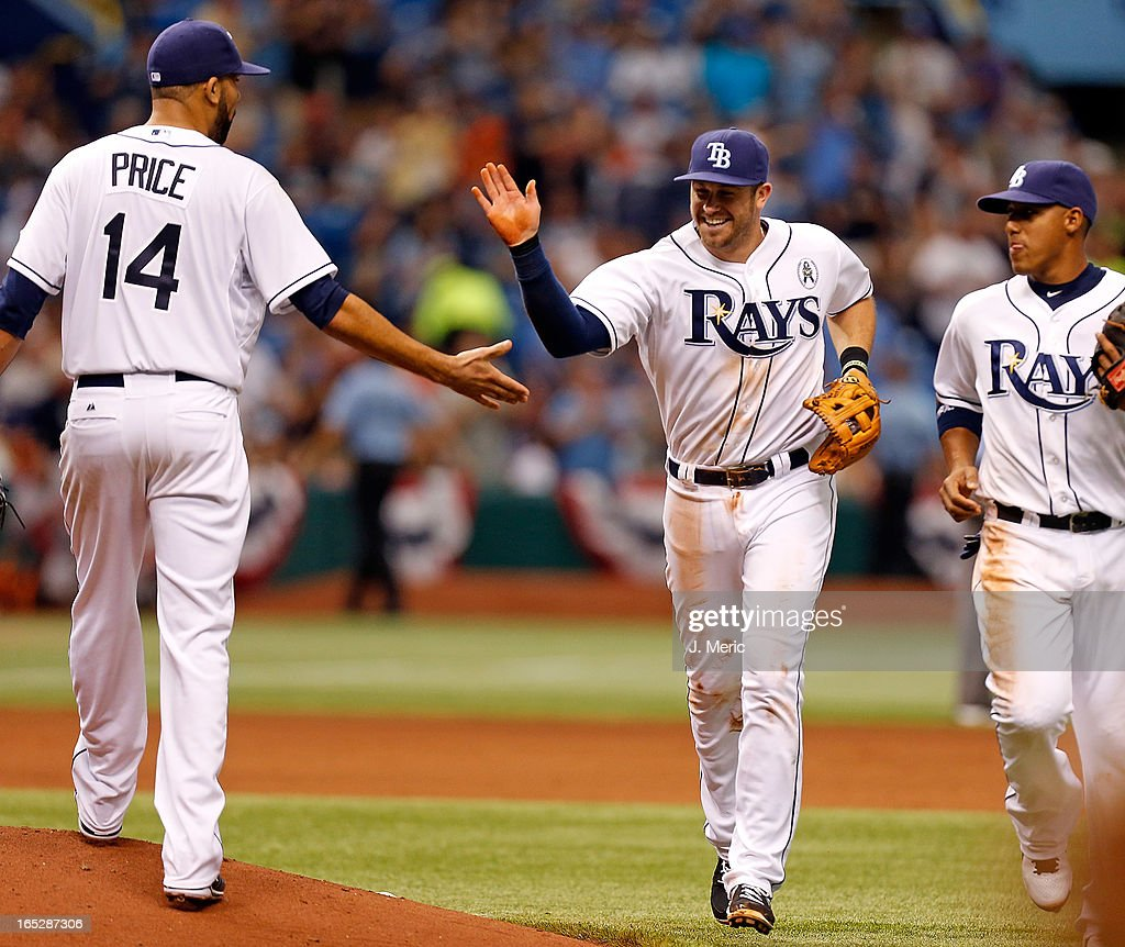Pitcher <a gi-track='captionPersonalityLinkClicked' href=/galleries/search?phrase=David+Price+-+Baseball+Player&family=editorial&specificpeople=4961936 ng-click='$event.stopPropagation()'>David Price</a> #14 of the Tampa Bay Rays congratulates <a gi-track='captionPersonalityLinkClicked' href=/galleries/search?phrase=Evan+Longoria&family=editorial&specificpeople=2349329 ng-click='$event.stopPropagation()'>Evan Longoria</a> #3 after he made a play against the Baltimore Orioles during the Opening Day game at Tropicana Field on April 2, 2013 in St. Petersburg, Florida.