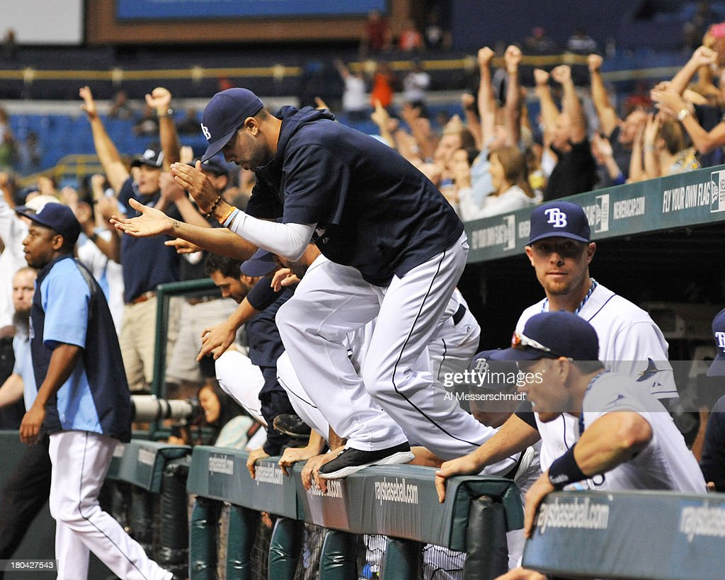 Pitcher David Price #14 of the Tampa Bay Rays jumps ove the dugout wall after the final out against the Boston Red Sox September 12, 2013 at Tropicana Field in St. Petersburg, Florida. The Rays won 4 - 3.