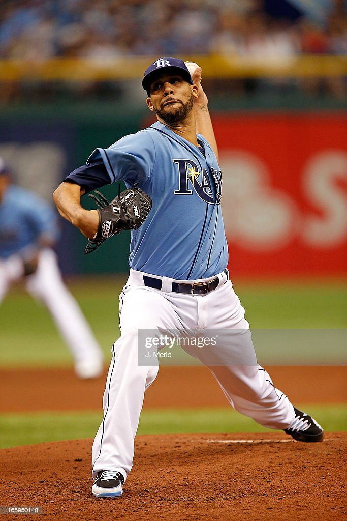 Pitcher <a gi-track='captionPersonalityLinkClicked' href=/galleries/search?phrase=David+Price+-+Baseball+Player&family=editorial&specificpeople=4961936 ng-click='$event.stopPropagation()'>David Price</a> #14 of the Tampa Bay Rays pitches against the Cleveland Indians during the game at Tropicana Field on April 7, 2013 in St. Petersburg, Florida.
