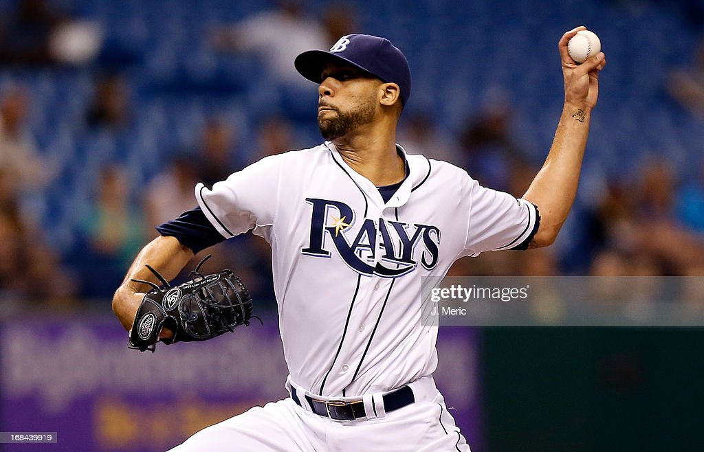 Pitcher <a gi-track='captionPersonalityLinkClicked' href=/galleries/search?phrase=David+Price+-+Baseball+Player&family=editorial&specificpeople=4961936 ng-click='$event.stopPropagation()'>David Price</a> #14 of the Tampa Bay Rays pitches against the Toronto Blue Jays during the game at Tropicana Field on May 9, 2013 in St. Petersburg, Florida.