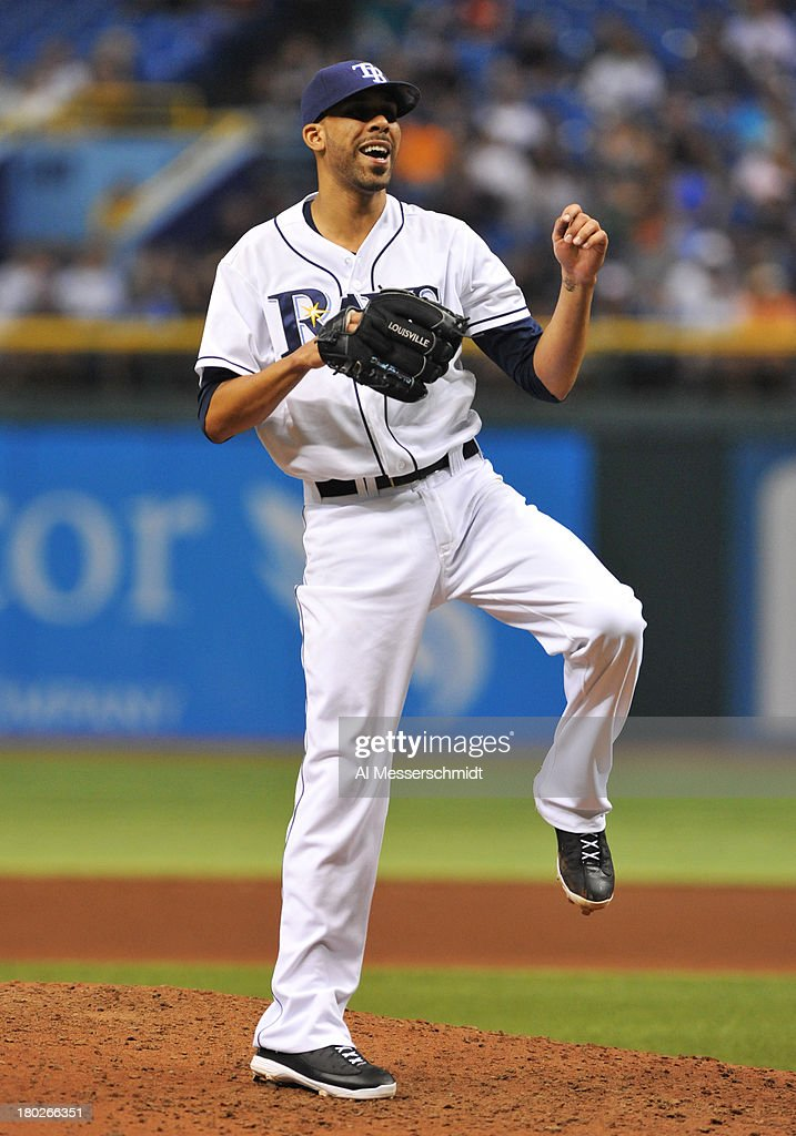 Pitcher <a gi-track='captionPersonalityLinkClicked' href=/galleries/search?phrase=David+Price+-+Honkballer&family=editorial&specificpeople=4961936 ng-click='$event.stopPropagation()'>David Price</a> #14 of the Tampa Bay Rays starts against the Boston Red Sox September 10, 2013 at Tropicana Field in St. Petersburg, Florida. Price gave up 3 hits in 8 innings and Boston won 2 - 0.