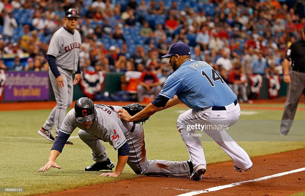 Pitcher David Price #14 of the Tampa Bay Rays tags out Mark Reynolds #12 of the Cleveland Indians in a run down during the game at Tropicana Field on April 7, 2013 in St. Petersburg, Florida.