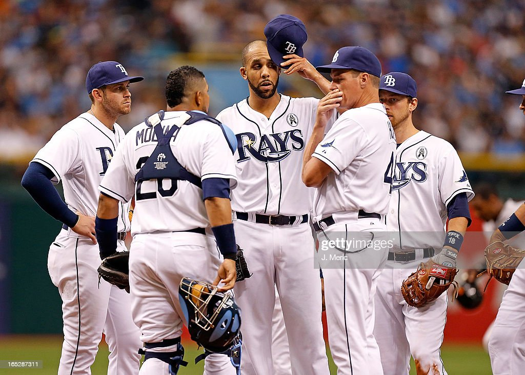 Pitcher <a gi-track='captionPersonalityLinkClicked' href=/galleries/search?phrase=David+Price+-+Baseball+Player&family=editorial&specificpeople=4961936 ng-click='$event.stopPropagation()'>David Price</a> #14 of the Tampa Bay Rays talks with pitching coach <a gi-track='captionPersonalityLinkClicked' href=/galleries/search?phrase=Jim+Hickey&family=editorial&specificpeople=643232 ng-click='$event.stopPropagation()'>Jim Hickey</a> #48 during the Opening Day game against the Baltimore Orioles at Tropicana Field on April 2, 2013 in St. Petersburg, Florida.