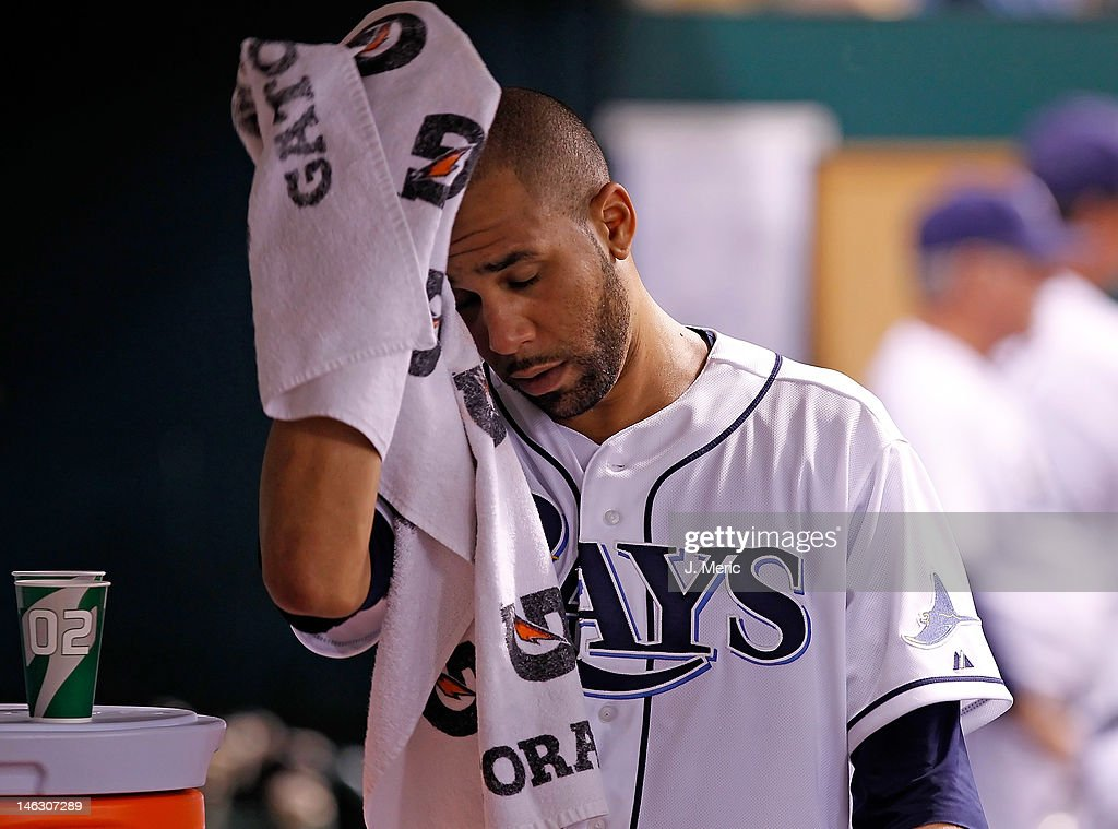 Pitcher <a gi-track='captionPersonalityLinkClicked' href=/galleries/search?phrase=David+Price+-+Baseball+Player&family=editorial&specificpeople=4961936 ng-click='$event.stopPropagation()'>David Price</a> #14 of the Tampa Bay Rays wipes his face after he left the game against the New York Mets at Tropicana Field on June 13, 2012 in St. Petersburg, Florida.