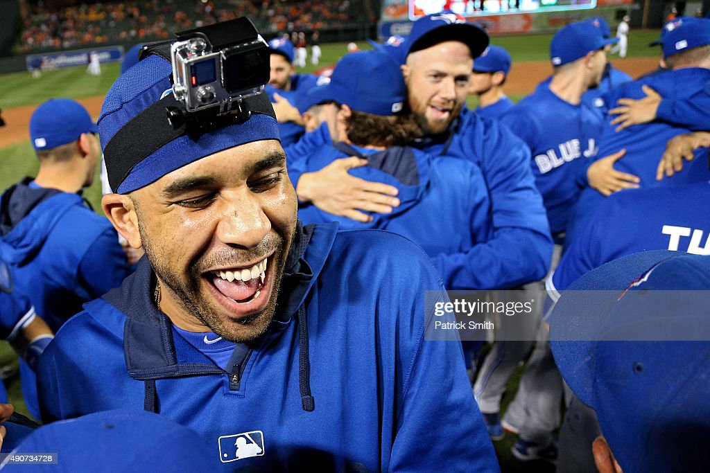 Pitcher <a gi-track='captionPersonalityLinkClicked' href=/galleries/search?phrase=David+Price+-+Baseball+Player&family=editorial&specificpeople=4961936 ng-click='$event.stopPropagation()'>David Price</a> #14 of the Toronto Blue Jays and teammates celebrate after defeating the Baltimore Orioles and clinching the AL East Division during game one of a double header at Oriole Park at Camden Yards on September 30, 2015 in Baltimore, Maryland.