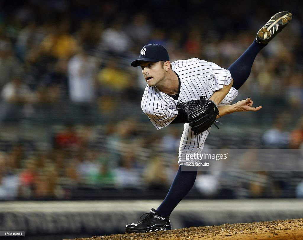 Pitcher David Robertson #30 of the New York Yankees delivers a pitch against the Chicago White Sox during the eighth inning in a MLB baseball game at Yankee Stadium on September 4, 2013 in the Bronx borough of New York City.
