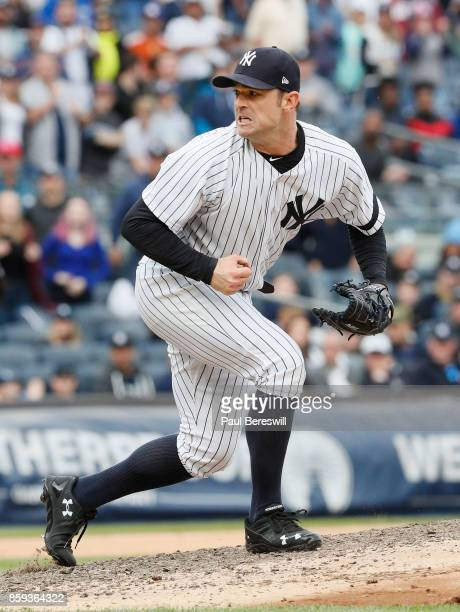 Pitcher David Robertson of the New York Yankees follows through and reacts to striking out Justin Smoak to end the 8th inning with runners on base in...