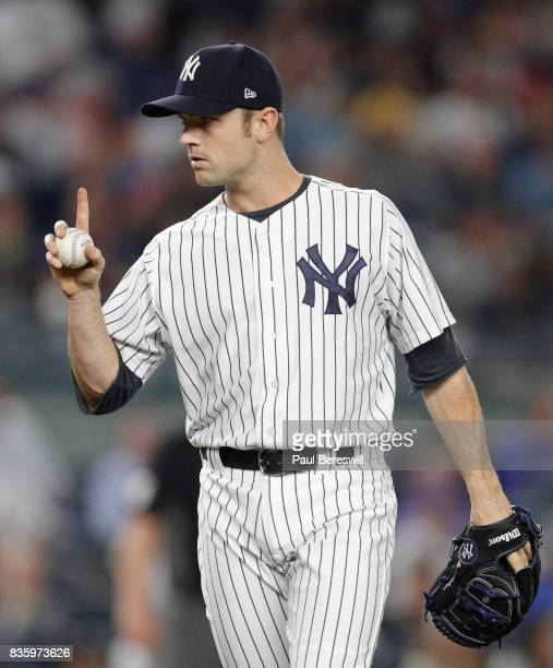 Pitcher David Robertson of the New York Yankees reacts in an MLB baseball game against the New York Mets on August 14 2017 at Yankee Stadium in the...