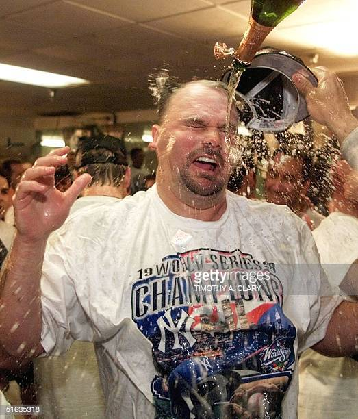 Pitcher David Wells of the New York Yankees is doused with champagne in the locker room following the Yankee's win in game four of the World Series...