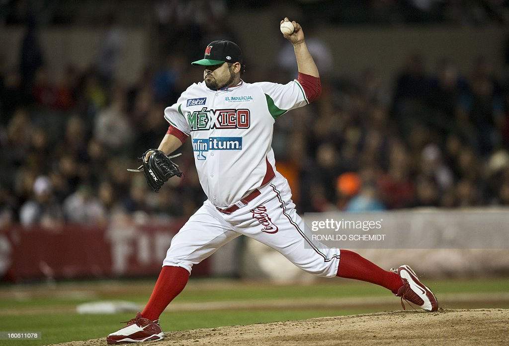 Pitcher Dennys Reyes of Yaquis de Obregon of Mexico pitches against Criollos de Caguas of Puerto Rico, at the Sonora Stadium, during the 2013 Baseball Caribbean Series, on February 1, 2013, in Hermosillo, Sonora State, northern Mexico. AFP PHOTO/Ronaldo Schemidt