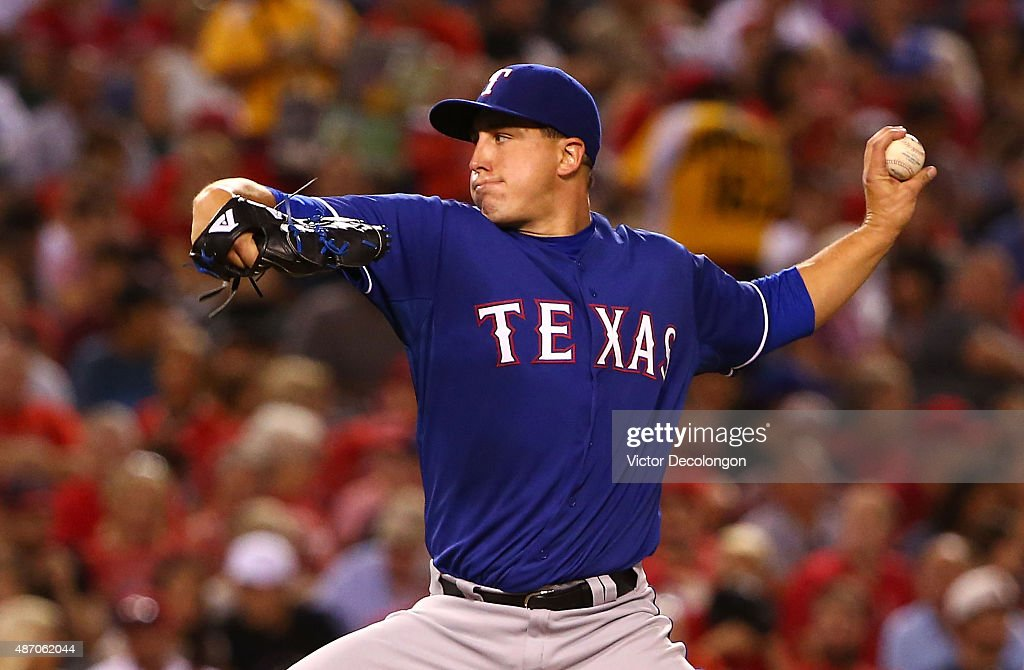 Pitcher <a gi-track='captionPersonalityLinkClicked' href=/galleries/search?phrase=Derek+Holland+-+Giocatore+di+baseball&family=editorial&specificpeople=8003703 ng-click='$event.stopPropagation()'>Derek Holland</a> #45 of the Texas Rangers pitches in the fifth inning during against the Los Angeles Angels of Anaheim the MLB game at Angel Stadium of Anaheim on September 5, 2015 in Anaheim, California.