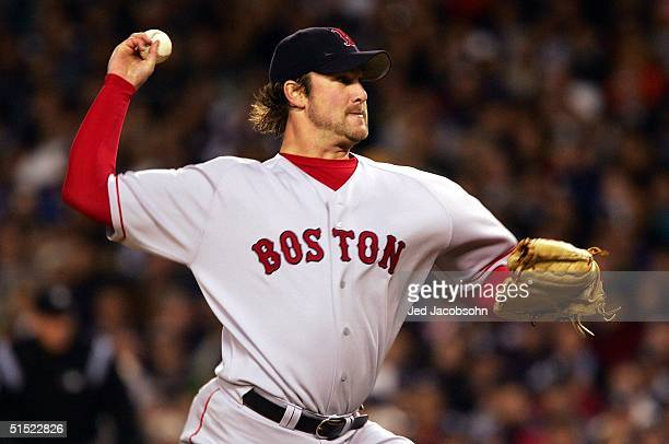 Pitcher Derek Lowe of the Boston Red Sox throws a pitch against the New York Yankees in the first inning during game seven of the American League...