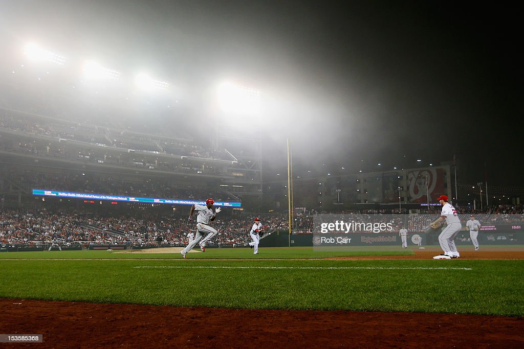 Pitcher <a gi-track='captionPersonalityLinkClicked' href=/galleries/search?phrase=Drew+Storen&family=editorial&specificpeople=5926519 ng-click='$event.stopPropagation()'>Drew Storen</a> #22 of the Washington Nationals throws the ball to first baseman <a gi-track='captionPersonalityLinkClicked' href=/galleries/search?phrase=Adam+LaRoche&family=editorial&specificpeople=216533 ng-click='$event.stopPropagation()'>Adam LaRoche</a> #25 to get out Domonic Brown #9 of the Philadelphia Phillies for the second out of the ninth inning at Nationals Park on October 2, 2012 in Washington, DC.