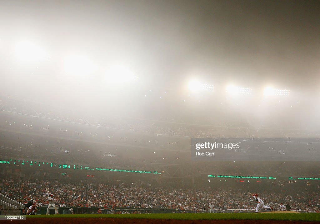 Pitcher <a gi-track='captionPersonalityLinkClicked' href=/galleries/search?phrase=Drew+Storen&family=editorial&specificpeople=5926519 ng-click='$event.stopPropagation()'>Drew Storen</a> #22 of the Washington Nationals throws to batter <a gi-track='captionPersonalityLinkClicked' href=/galleries/search?phrase=John+Mayberry+Jr.&family=editorial&specificpeople=4959058 ng-click='$event.stopPropagation()'>John Mayberry Jr.</a> #15 of the Philadelphia Phillies during the ninth inning at Nationals Park on October 2, 2012 in Washington, DC.