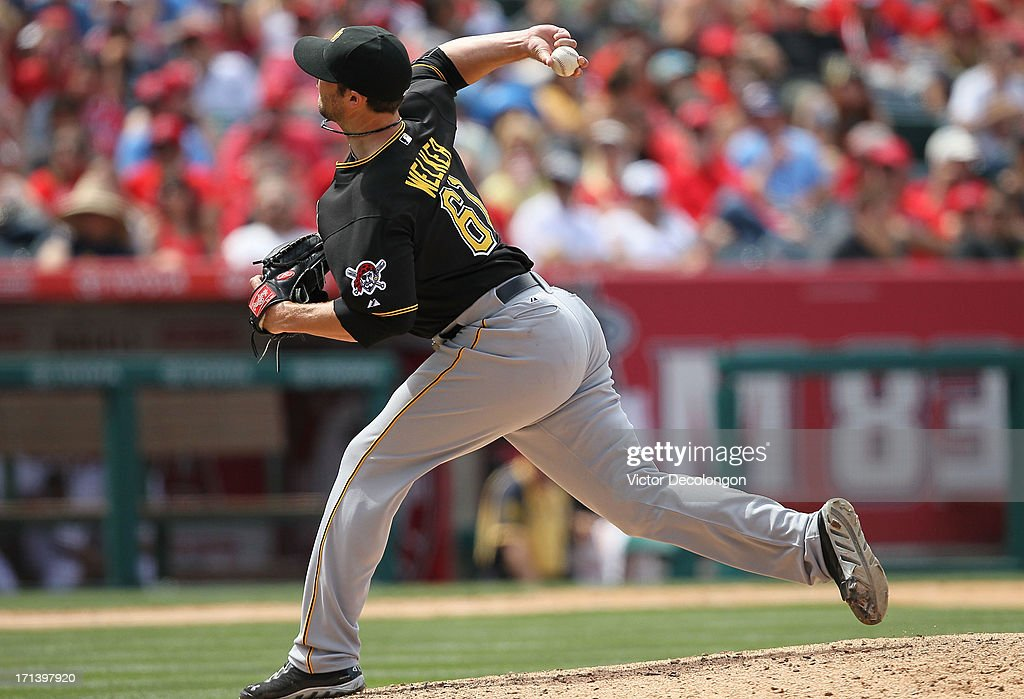 Pitcher Duke Welker #61 of the Pittsburgh Pirates pitches in the eighth inning during the MLB game against the Los Angeles Angels of Anaheim at Angel Stadium of Anaheim on June 23, 2013 in Anaheim, California. The Pirates defeated the Angels 10-9 in ten innings.