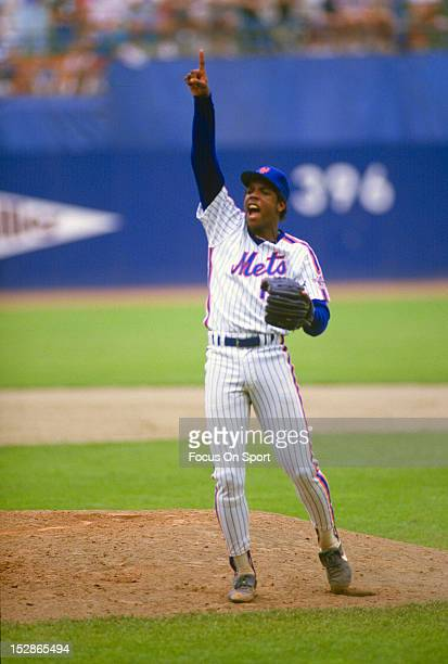 Pitcher Dwight Gooden of the New York Mets points to a popup on the infield during an Major League Baseball game circa 1986 at Shea Stadium in the...