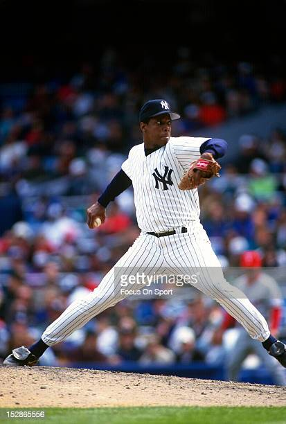 Pitcher Dwight Gooden of the New York Yankees pitches during an Major League Baseball game circa 1996 at Yankee Stadium in the Bronx borough of New...