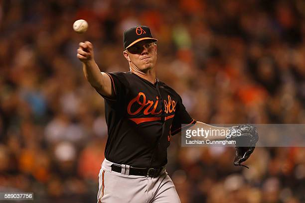 Pitcher Dylan Bundy of the Baltimore Orioles fields the ball and throws to first to get the out of Brandon Crawford of the San Francisco Giants...