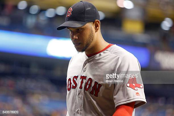 Pitcher Eduardo Rodriguez of the Boston Red Sox makes his way to the dugout after being taken off the mound by manager John Farrell after allowing a...