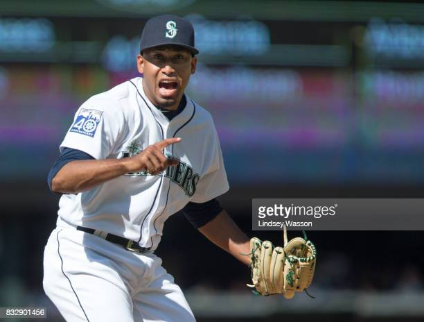 Pitcher Edwin Diaz of the Seattle Mariners reacts after hitting Trey Mancini of the Baltimore Orioles in the ninth inning at Safeco Field on August...