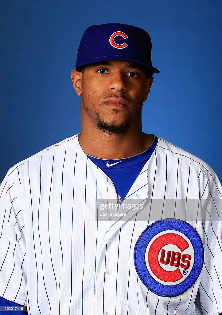 Pitcher <a gi-track='captionPersonalityLinkClicked' href=/galleries/search?phrase=Edwin+Jackson&family=editorial&specificpeople=220506 ng-click='$event.stopPropagation()'>Edwin Jackson</a> #36 poses during Chicago Cubs photo day on February 18, 2013 at HoHoKam Park in Mesa, Arizona.