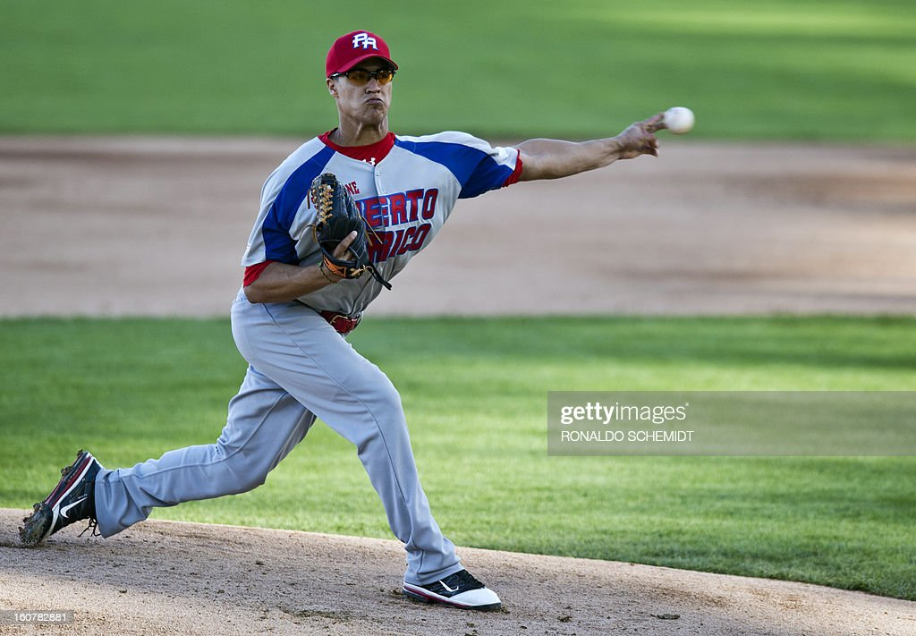 Pitcher Efrain Nieves of Criollos de Caguas of Puerto Rico, pitches against Magallanes of Venezuela, during the 2013 Caribbean baseball series, on February 5, 2013, in Hermosillo, Sonora State, in the northern of Mexico. AFP PHOTO/Ronaldo Schemidt