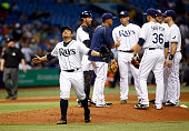 Pitcher Erasmo Ramirez of the Tampa Bay Rays reacts as he walks back to he dugout after giving up a nohitter in the eighth inning and being taken out...