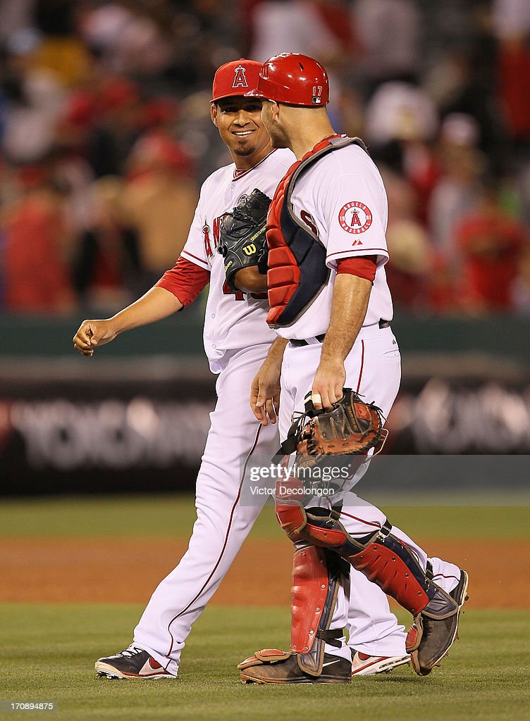Pitcher <a gi-track='captionPersonalityLinkClicked' href=/galleries/search?phrase=Ernesto+Frieri&family=editorial&specificpeople=4947122 ng-click='$event.stopPropagation()'>Ernesto Frieri</a> #49 of the Los Angeles Angels of Anaheim smiles at catcher <a gi-track='captionPersonalityLinkClicked' href=/galleries/search?phrase=Chris+Iannetta&family=editorial&specificpeople=836137 ng-click='$event.stopPropagation()'>Chris Iannetta</a> #17 after they defeated the Seattle Mariners 1-0 in their MLB game at Angel Stadium of Anaheim on June 19, 2013 in Anaheim, California. The Angels defeated the Mariners 1-0.